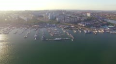 Aerial Photo. City Yacht Club at sunset Stock Footage