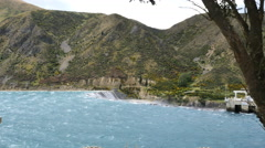 New Zealand water over dam on a windy day Stock Footage