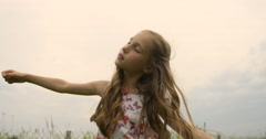 Portrait of a baby girl spinning in a field in sunset light, life style Stock Footage