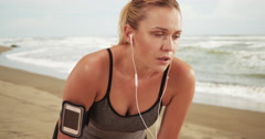 Woman runner resting after long run Stock Footage