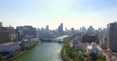 Japanese man walks to work in Suit aerial reveal shot Osaka city Skyline  Stock Footage