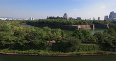 Wide angle moving aerial shot Osaka Castle park Attraction  Stock Footage