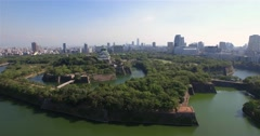 Osaka Castle aerial view ascending wide angle shot Stock Footage