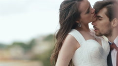 Close-up of beayutiful wedding couple ardently kissing on wedding day. Young Stock Footage