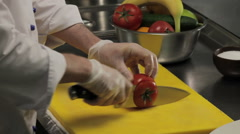 Chef slicing fresh tomato into rings, close up Stock Footage