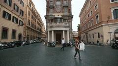 Wedding couple walks on city street in Rome, Italy. Stylish groom and beautiful Stock Footage