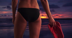 Rear view of woman standing by the beach at sunset Stock Footage