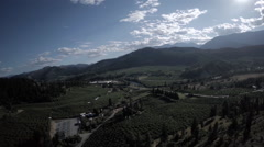 Aerial View: Orchard and Mountain Vistas in The Summer Stock Footage