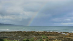 New Zealand Kaka Point rainbow over tide pools Stock Footage