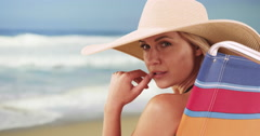 Closeup of woman sitting by the beach Stock Footage