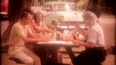 family stops at roadside picnic table for lunch 3532-vintage film home movie Stock Footage