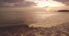 Surfers Waiting For Waves at Sunset on Tropical Thai Beach, Pullback Reveal Stock Footage
