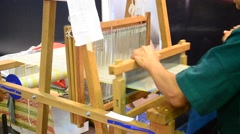 Thai people using small loom or weaving machine for weaving Stock Footage