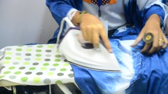Thai women use iron ironing the clothes for sale Stock Footage
