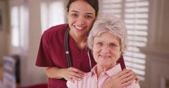 Latina caretaker with senior woman smiling Stock Footage