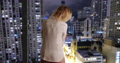 Sexy woman standing by hotel window - stock footage