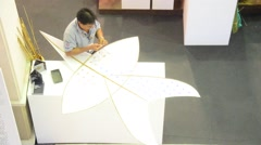 Thai senior men people making and build star-shaped kite or thai name Chula kite Stock Footage