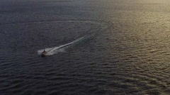 Seadoo At Golden hour Wide Turn on Lake Stock Footage
