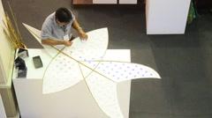 Thai senior men people making and build star-shaped kite or thai name Chula kite Stock Footage