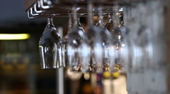 Glasses hanging upside down in cafe restaurant wine Stock Footage