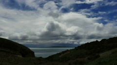 New Zealand clouds from Nugget Point Road time lapse Stock Footage
