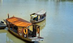 Traditional boats on Sarawak river in Kuching city Stock Photos
