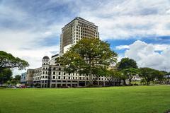 Cotton Silk Tree and Merdeka Palace Hotel in Kuching Stock Photos