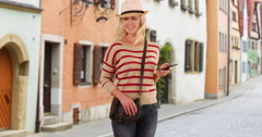 Happy woman tourist looking around a new city Stock Footage