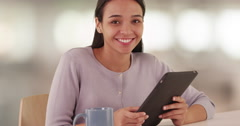 Hispanic bible student smiling with tablet Stock Footage