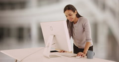 Hardworking Mexican businesswoman typing at desk Stock Footage