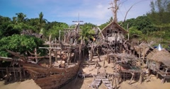 Hippy Bar and Pirate Ship Made From Floatsam, Koh Phayam Thailand, Aerial Shot Stock Footage