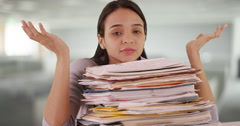Mexican woman intern overloaded with paperwork Stock Footage