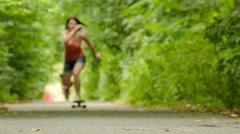 4K. Young beautiful girl figure  goes on  skateboard Stock Footage