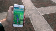 4K Man playing Pokemon Go on App in a street city of Asia, used smart phone-Dan Stock Footage