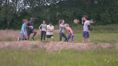 4K Competitive team in assault course race warming up at the starting line. Stock Footage