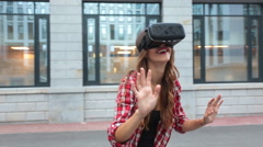 Woman using a virtual reality device Stock Footage