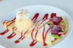 Fruity crape and  ice cream Stock Photos