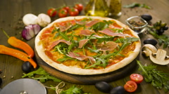 Pizza with bacon, and ingredients on background Stock Footage