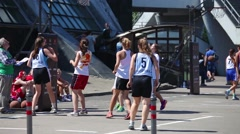 Girls playing outdoor street basketball tournament 3x3 Stock Footage