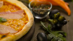 Pizza with bacon, eag and ingredients on background Stock Footage