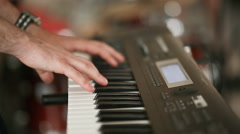 The hands of the musician played on a synthesiser Stock Footage