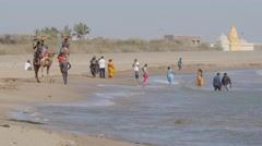 Tourists riding camels on beach,Veraval,Somnath,India Stock Footage