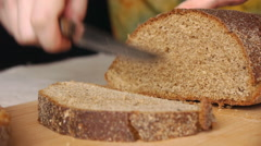 Cutting Bread With The Knife Stock Footage