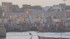 Fishermen boat returning in harbour,Veraval,India Stock Footage