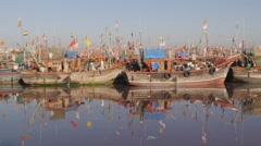 Harbour with fishermen unloading boat,Veraval,India Stock Footage