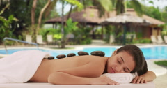 Mexican woman enjoying massage at a resort Stock Footage