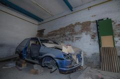 Disassembled old blue car in a workshop Stock Photos