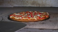 Taking Cooked Gluten Free Pizza Out Of Hot Commercial Industrial Stone Oven Stock Footage