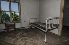 Abandoned room with an old bed Stock Photos