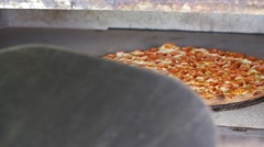 Taking Cooked Pepperoni Pizza Out Of Hot Commercial Industrial Stone Oven Stock Footage